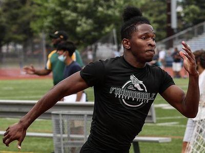 Andre Leslie of Farmingdale wins the 400 meter