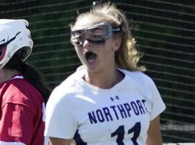 Northport's top scorer Kaylie Mackiewicz (11) reacts after