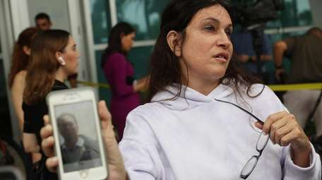 Soriya Cohen shows a picture of her husband,