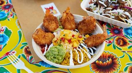 Coconut shrimp burrito bowl with rice, lettuce, black
