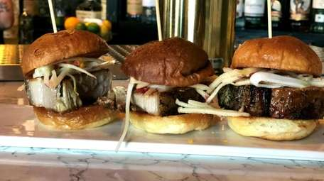Pork-belly sliders at The Watershed Kitchen + Bar
