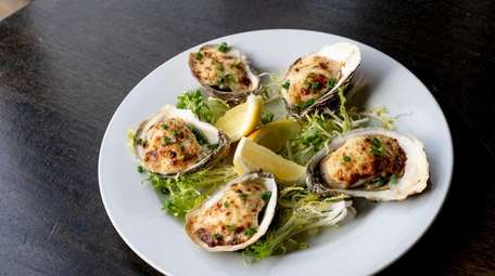 Peconic Gold Oysters Friskafella with garlic spinach, chipotle,