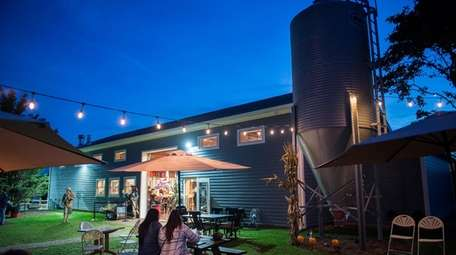 Guests gather outside at the Jamesport Farm Brewery