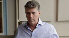 Hal Steinbrenner of the Yankees talks with reporters