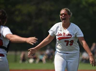 Erin Cunningham #73, Center Moriches pitcher, right, and
