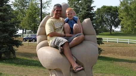 Andrew Capobianco, right, with his father, Mike, at