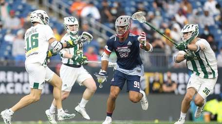 Cannons' Paul Rabil (99) carries the ball against