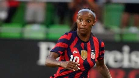 Crystal Dunn #19 of the United States controls