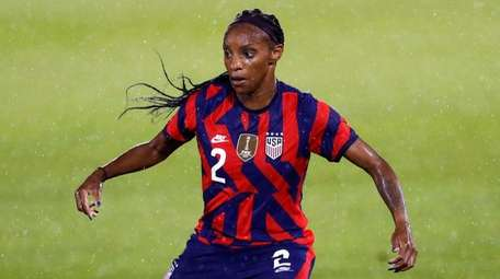 Crystal Dunn of the United States dribbles downfield