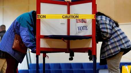 Caution tape closes off a voting stall to