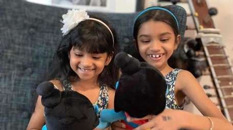 Sisters Zara, 7, and Roma Seelall, 8, of