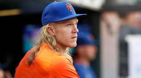 Noah Syndergaard of the Mets looks on from