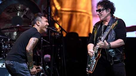 Journey, featuring singer Arnel Pineda and guitarist Neal