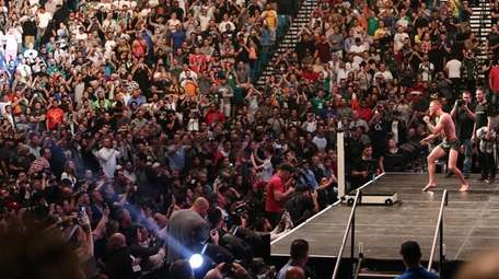 Conor McGregor of Ireland entertains the fans during