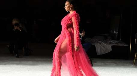 A model walks the runway during the Christian