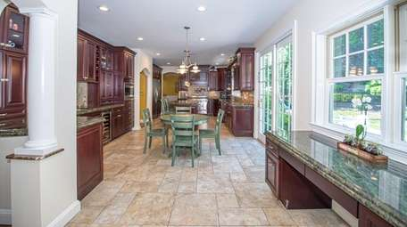 The oversized chef's kitchen has high-end appliances and