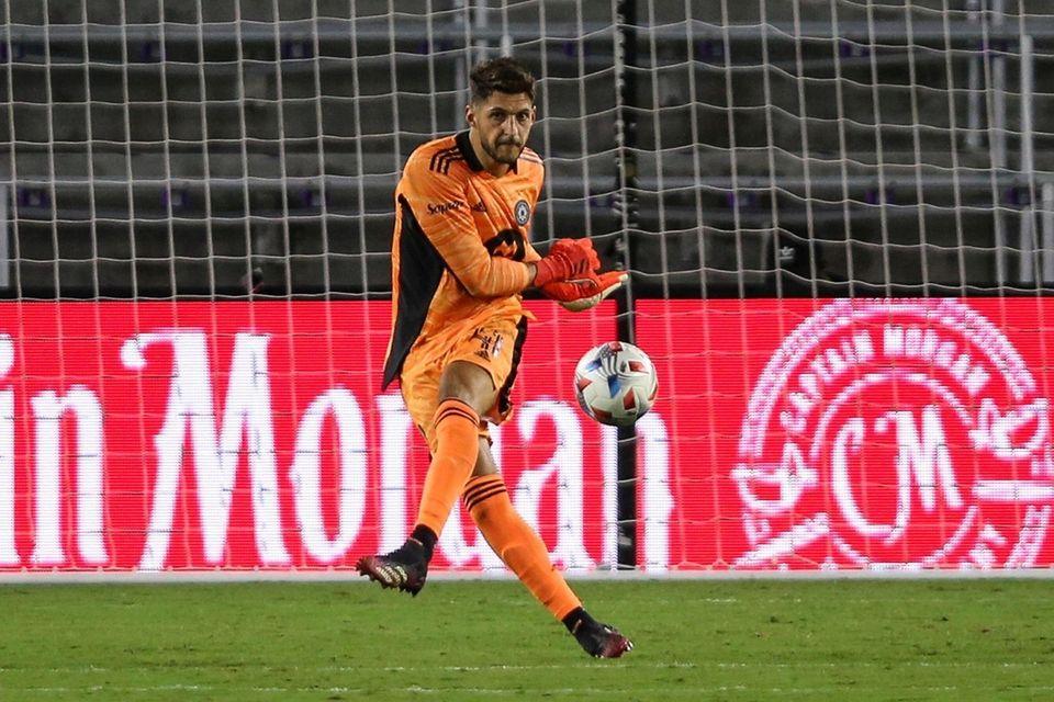 CF Montreal goalkeeper James Pantemis (41) clears the