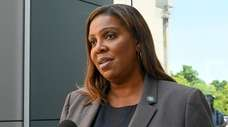 State Attorney General Letitia James speaks to reporters