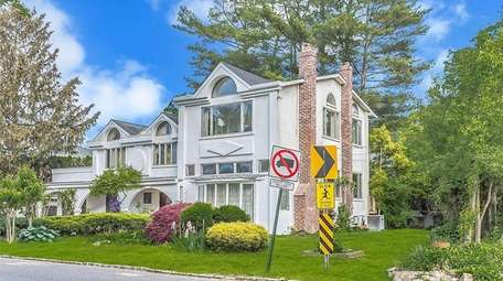 This home in Roslyn Heights, priced at $1.099M,