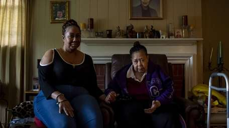 Constance Dunlap holds the hand of her mother,