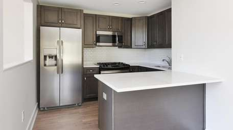 The kitchen has stainless steel appliances and gas