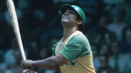 Reggie Jackson of the A's watches the flyball