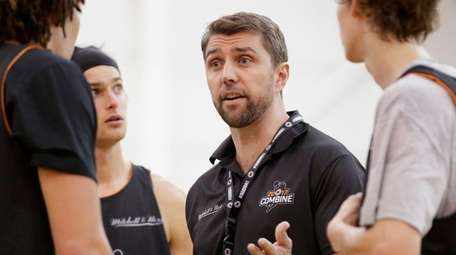 Adam Caporn gives instructions during the NBL Combine