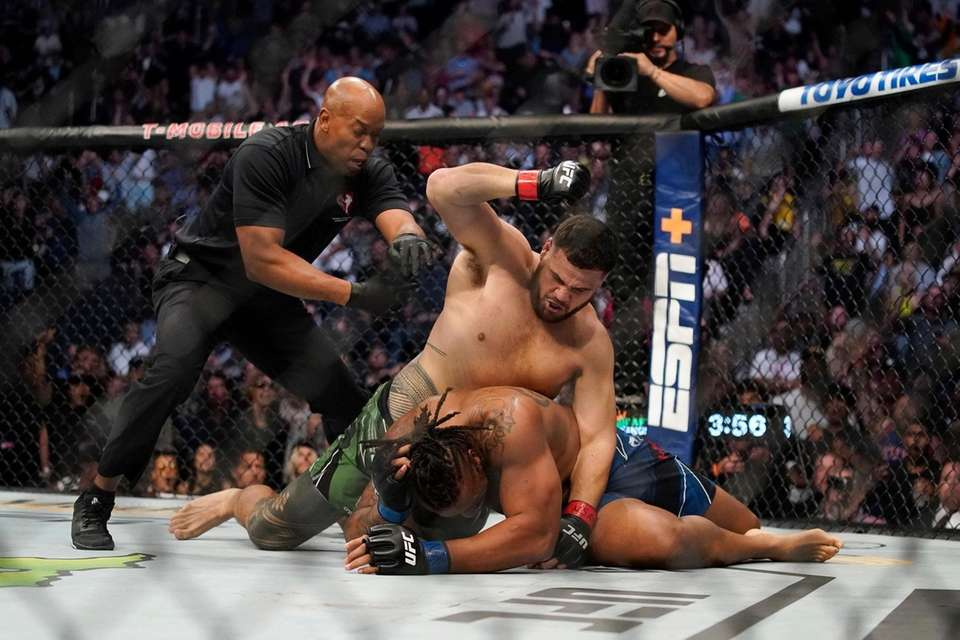 Tai Tuivasa, top, fights Greg Hardy during a