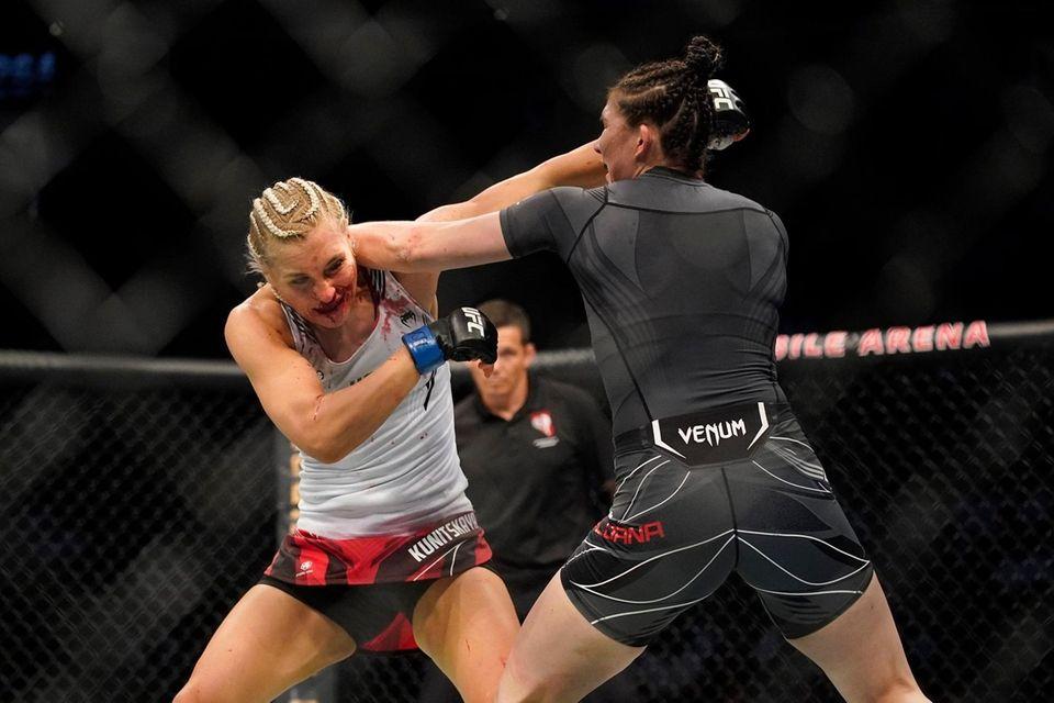Irene Aldana, right, punches Yana Kunitskaya during a