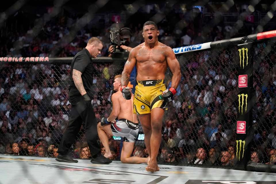 Gilbert Burns celebrates after defeating Stephen Thompson in