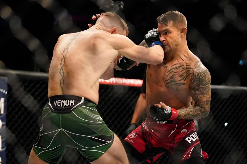 Conor McGregor, left, fights Dustin Poirier during a