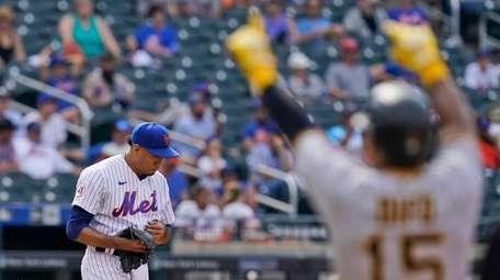 Mets relief pitcher Edwin Diaz, left, reacts after