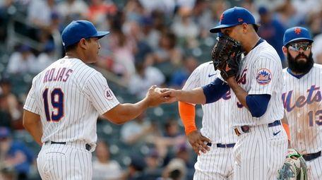 Edwin Diaz #39 of the Mets hands the