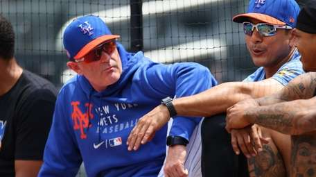 Manager Luis Rojas #19 of the Mets sits