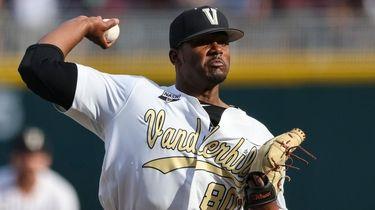 Vanderbilt pitcher Kumar Rocker throws during the first