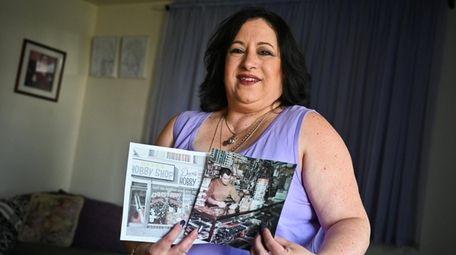 Maralin Merklin-Gray with photos of Dave's Hobby Shop,