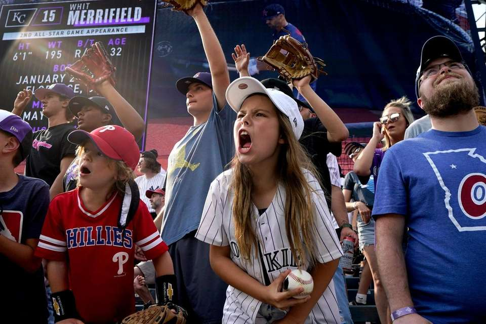 Fans cheer during batting practice prior to the