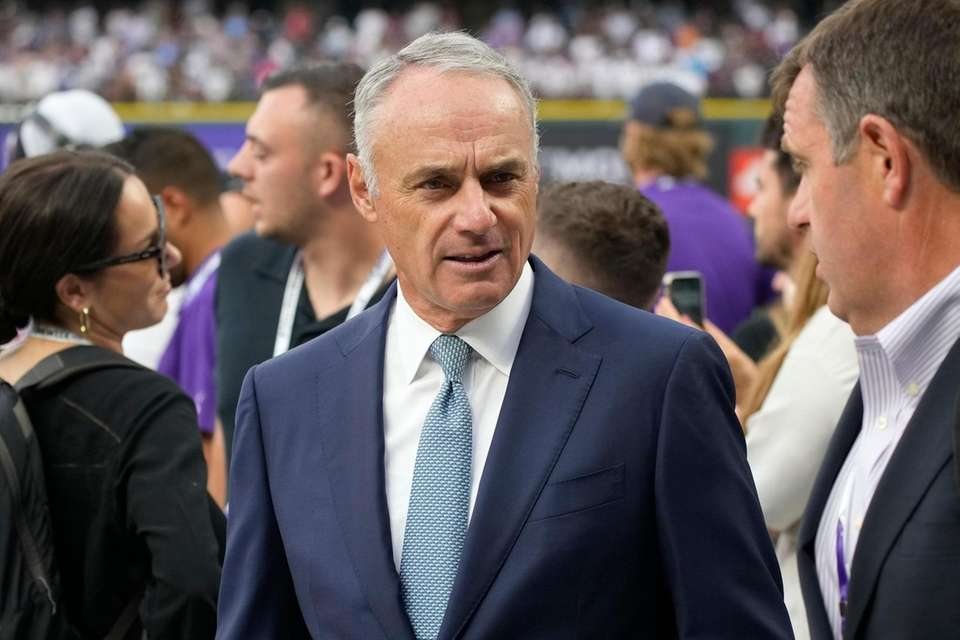 MLB Commisioner Rob Manfred watches batting practice prior