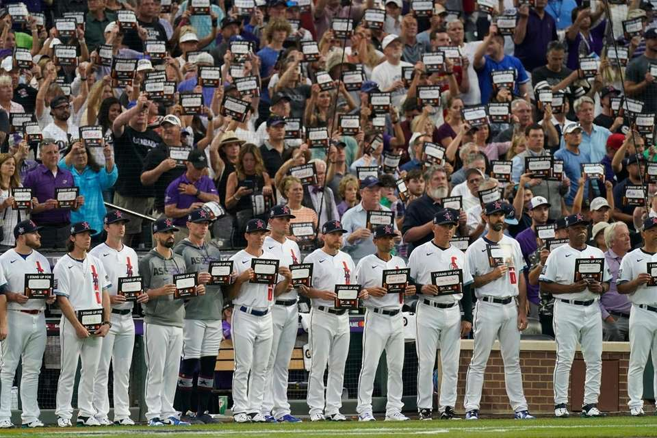 National League players hold signs for cancer awareness