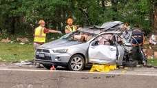 Investigators at the scene of a fatal crash