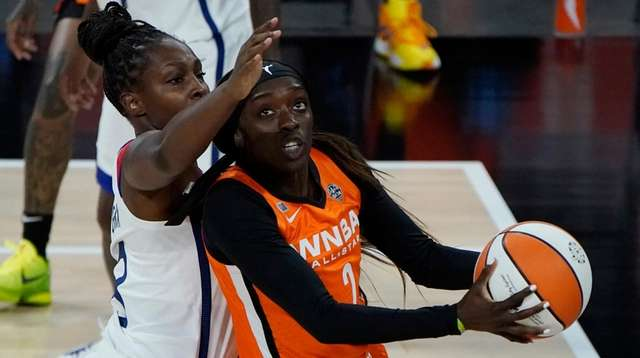 Team WNBA's Kahleah Copper shoots around United States'