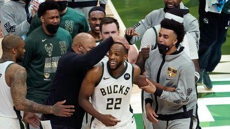 Bucks forward Khris Middleton celebrates with teammates during