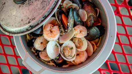 The seafood bucket of shrimp, mussels and clams