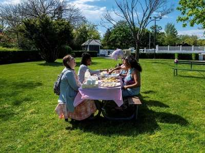 A group of women enjoy an afternoon picnic