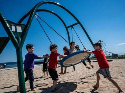 Children play in a playground at the Bellport