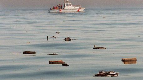 Crewmen aboard a U.S. Coast Guard boat pickup