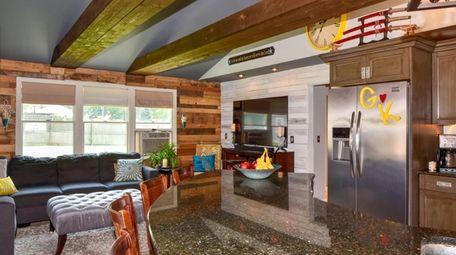 The kitchen has wood beams and a semi-circular