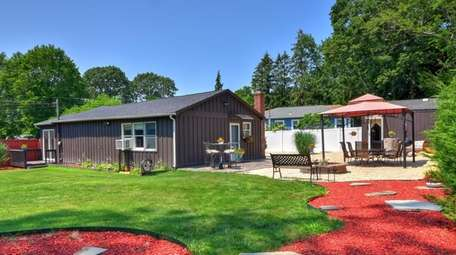 The quarter-acre property has a fenced-in yard with