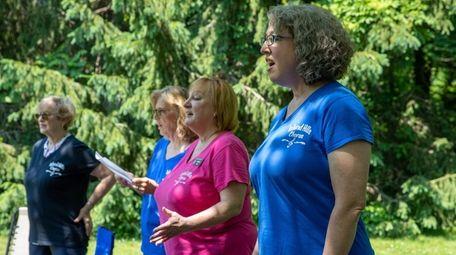 Island Hills Chorus member Cindy Simon, right, says