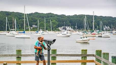 A man and his grandson look across Northport